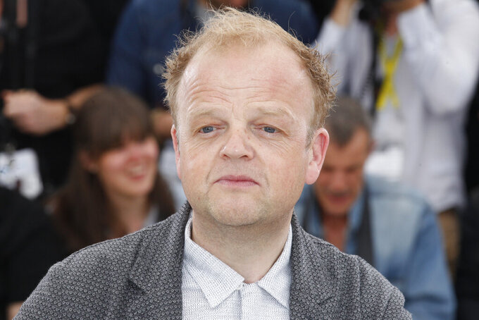 "FILE - In this Thursday, May 14, 2015 file photo, actor Toby Jones poses during a photo call for the film Tale of Tales, at the 68th international film festival, Cannes, southern France. The Queen's New Year honors list was annouced Wednesday, Dec. 30, 2020. Actress Lesley Manville, an Oscar nominee for ""Phantom Thread,"" was named a Commander of the Order of the British Empire, or CBE. Actor Toby Jones, whose credits include Dobby in the ""Harry Potter"" movies, was made an Officer of the Order of the British Empire or OBE, as was writer Jed Mercurio, creator of gripping TV detective series ""Line of Duty."" (AP Photo/Lionel Cironneau,file)"