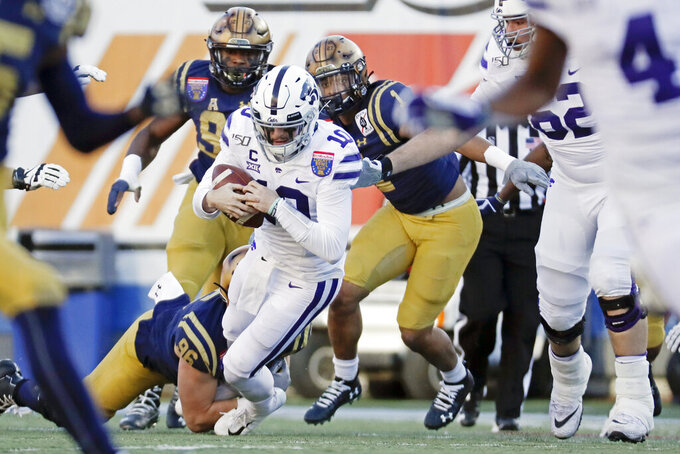 Kansas State quarterback Skylar Thompson (10) is sacked by Navy defensive end Jackson Perkins (96) for a 4-yard loss in the first half of the Liberty Bowl NCAA college football game Tuesday, Dec. 31, 2019, in Memphis, Tenn. (AP Photo/Mark Humphrey)