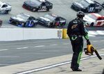 A crewman blows out a pit stall as cars come around before a NASCAR Cup Series auto race, Sunday, April 15, 2018, in Bristol, Tenn. (AP Photo/Wade Payne)