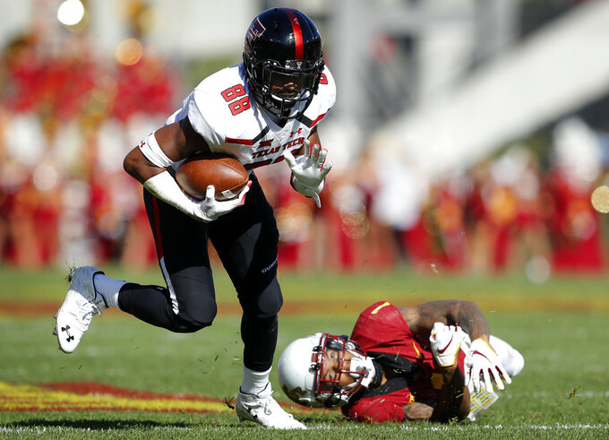 Texas Tech wide receiver Ja'Deion High (88) breaks a tackle by Iowa State defensive back D'Andre Payne, right, after making a reception during the first half of an NCAA college football game, Saturday, Oct. 27, 2018, in Ames, Iowa. (AP Photo/Charlie Neibergall)
