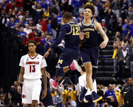 APTOPIX Michigan Louisville Basketball