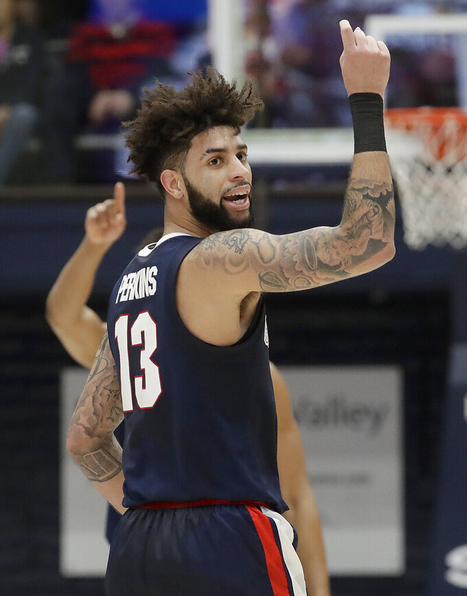 Gonzaga guard Josh Perkins (13) gestures after scoring against Saint Mary's during the first half of an NCAA college basketball game in Moraga, Calif., Saturday, March 2, 2019. (AP Photo/Jeff Chiu)