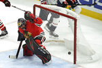 Chicago Blackhawks goalie Corey Crawford misses a goal scored by Washington Capitals' T.J. Oshie during the first period of an NHL hockey game Sunday, Oct. 20, 2019, in Chicago. (AP Photo/Paul Beaty)