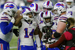 Buffalo Bills wide receiver Stefon Diggs (14) celebrates his touchdown with teammates in the second half of an NFL football game against the New England Patriots, Monday, Dec. 28, 2020, in Foxborough, Mass. (AP Photo/Elise Amendola)