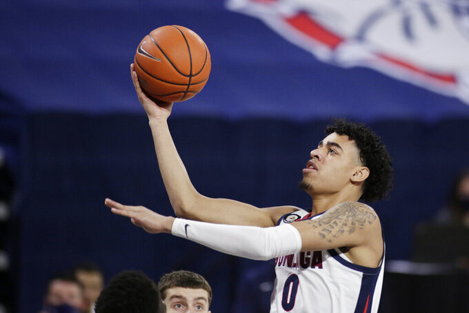 Gonzaga guard Julian Strawther (0) shoots during the second half of an NCAA college basketball game against San Francisco in Spokane, Wash., Saturday, Jan. 2, 2021. Gonzaga won 85-62. (AP Photo/Young Kwak)