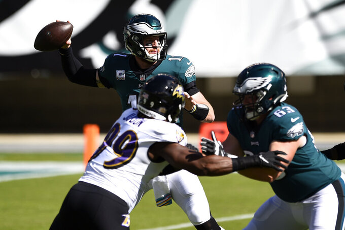 Philadelphia Eagles' Carson Wentz plays during the first half of an NFL football game against the Baltimore Ravens, Sunday, Oct. 18, 2020, in Philadelphia. (AP Photo/Derik Hamilton)