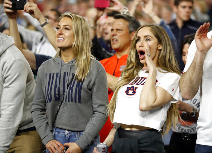 Fans cheer during the first half in the semifinals of the Final Four NCAA college basketball tournament between Auburn and Virginia, Saturday, April 6, 2019, in Minneapolis. (AP Photo/Jeff Roberson)