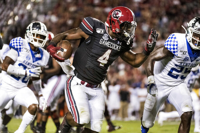 South Carolina running back Tavien Feaster (4) runs with the ball for a touchdown during the second half of an NCAA college football game against Kentucky, Saturday, Sept. 28, 2019, in Columbia, S.C. South Carolina defeated Kentucky 24-7. (AP Photo/Sean Rayford)