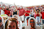With cutout fans in front of them, Oklahoma fans raise their fingers during the playing of the school's alma mater before an NCAA college football game against Missouri State in Norman, Okla., Saturday, Sept. 12, 2020. (Ian Maule/Tulsa World via AP)