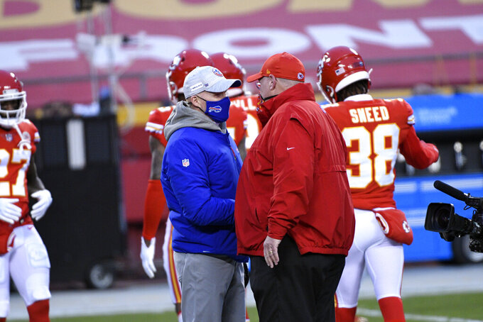 Buffalo Bills head coach Sean McDermott, left, talks with Kansas City Chiefs head coach Andy Reid before the AFC championship NFL football game, Sunday, Jan. 24, 2021, in Kansas City, Mo. (AP Photo/Reed Hoffmann)