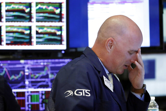 Specialist John O'Hara works on the floor of the New York Stock Exchange, Thursday, Oct. 11, 2018. Stocks are slumping for a second straight day as the market endures its most volatile stretch since February. (AP Photo/Richard Drew)