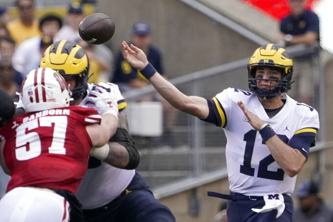 Michigan's Cade McNamara throws during the first half of an NCAA college football game against Wisconsin Saturday, Oct. 2, 2021, in Madison, Wis. (AP Photo/Morry Gash)