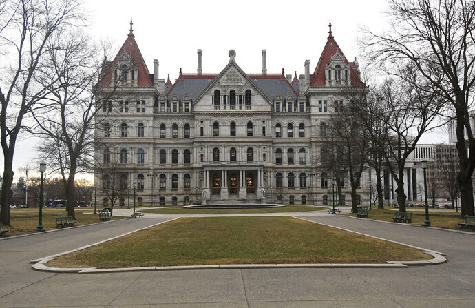 FILE- This Jan. 15, 2019 file photo shows the New York state Capitol in Albany, N.Y.    Andrea Stewart-Cousins' national profile is rising after she led the Democratic takeover of the state Senate.  The Yonkers Democrat and Senate majority leader last week was tapped to lead the national Democratic Legislative Campaign Committee.  That's a group that works to elect Democrats to state legislatures.   (AP Photo/Hans Pennink, File)