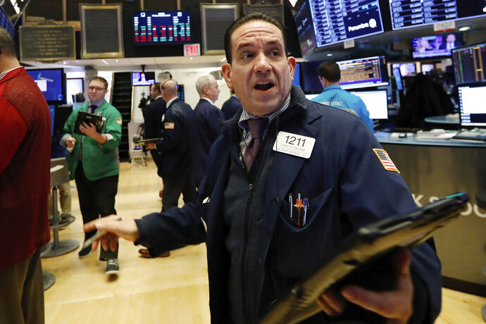 Trader Tommy Kalikas works on the floor of the New York Stock Exchange, Friday, Jan. 11, 2019. Stocks are opening broadly lower on Wall Street, led by declines in banks and technology companies. (AP Photo/Richard Drew)