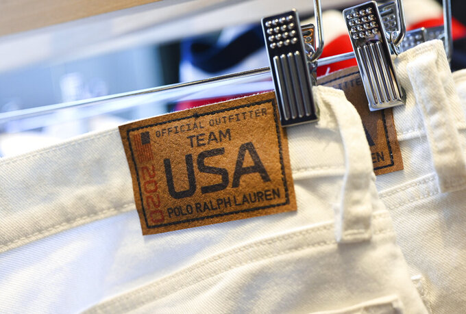 Team USA Tokyo Olympic closing ceremony uniforms are displayed during the unveiling at the Ralph Lauren SoHo Store on April 13, 2021, in New York. Ralph Lauren is an official outfitter of the U.S. Olympic Team. (Photo by Evan Agostini/Invision/AP)