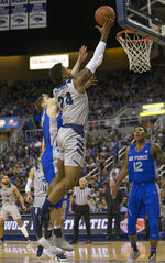 Nevada forward Jordan Caroline (24) lays the ball in against Air Force in the first half of an NCAA college basketball game in Reno, Nev., Saturday, Jan. 19, 2019. (AP Photo/Tom R. Smedes)