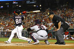 Washington Nationals' Gerardo Parra, left, doubles in front of Cleveland Indians catcher Roberto Perez, center, and umpire Joe West in the second inning of a baseball game, Friday, Sept. 27, 2019, in Washington. Kurt Suzuki and Howie Kendrick scored on the play. (AP Photo/Patrick Semansky)