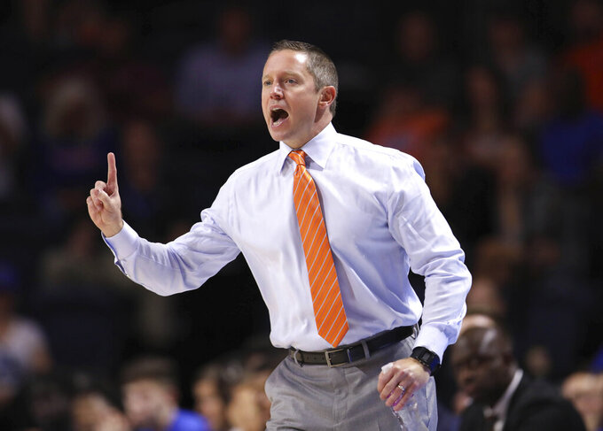 Florida head coach Mike White gives instructions against North Florida during the first half of an NCAA college basketball game Tuesday, Nov. 5, 2019, in Gainesville, Fla. (AP Photo/Matt Stamey)