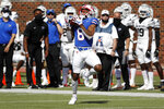 SMU wide receiver Reggie Roberson Jr. (8) catches a pass and runs in for a touchdown during the first half of an NCAA college football game against Memphis in Dallas, Saturday, Oct. 3, 2020. (AP Photo/Roger Steinman)