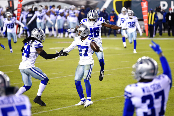 Dallas Cowboys' Trevon Diggs (27) celebrates with teammates after intercepting a pass by Philadelphia Eagles' Carson Wentz during the first half of an NFL football game, Sunday, Nov. 1, 2020, in Philadelphia. (AP Photo/Derik Hamilton)