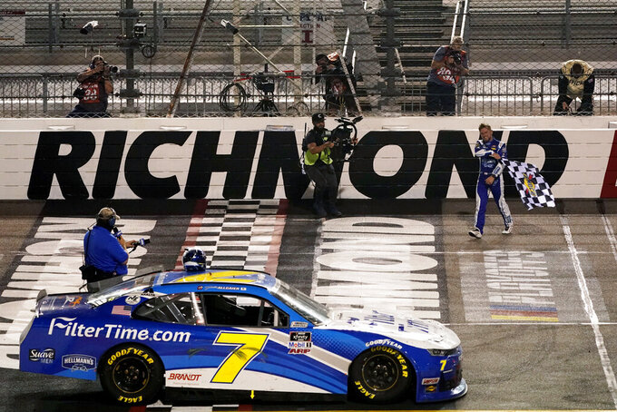 Justin Allgaier, right, celebrates after winning a NASCAR Xfinity Series auto race Friday, Sept. 11, 2020, in Richmond, Va. (AP Photo/Steve Helber)