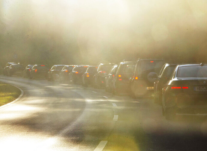 File---Picture taken Oct.31, 2018 shows cars queuing in a traffic jam when commuting to Frankfurt, Germany.  (AP Photo/Michael Probst)