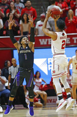 Utah guard Sedrick Barefield (2) shoots as Washington guard David Crisp (1) defends during the first half of an NCAA college basketball game Thursday, Jan., 10, 2019, in Salt Lake City. (AP Photo/Rick Bowmer)