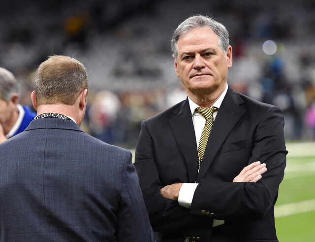 FILE - In this Dec. 30, 2018, file photo, New Orleans Saints general manager Mickey Loomis stands on the field before the team's NFL football game against the Carolina Panthers in New Orleans. The 2020 NFL Draft is April 23-25. (AP Photo/Bill Feig, File)