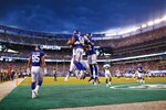 New York Giants wide receiver Bennie Fowler (18) celebrates with teammates, including Wayne Gallman (22) and Rhett Ellison (85), after scoring a touchdown during the first half of a preseason NFL football game against the New York Jets on Thursday, Aug. 8, 2019, in East Rutherford, N.J. (AP Photo/Adam Hunger)