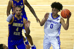 Kentucky's Jacob Toppin (0) looks for a teammate while defended by Morehead State's Johni Broome (4) during the second half of an NCAA college basketball game in Lexington, Ky., Wednesday, Nov. 25, 2020. Kentucky won 81-45. (AP Photo/James Crisp)