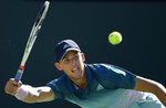 Dominic Thiem, of Austria, returns a shot to Roger Federer, of Switzerland, during the men's final at the BNP Paribas Open tennis tournament Sunday, March 17, 2019, in Indian Wells, Calif. (AP Photo/Mark J. Terrill)