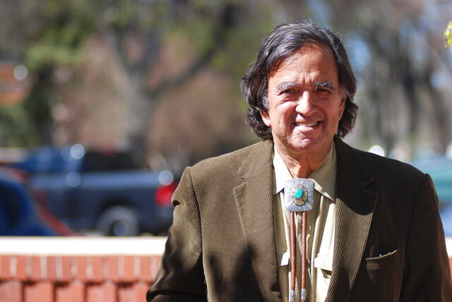 Former New Mexico Gov. Bill Richardson emerges from his office in Santa Fe, N.M., Thursday, March 9, 2020. Richardson is spearheading a charitable fund drive to help supply the Navajo Nation in New Mexico with personal protection and medical equipment to stem the spread of the coronavirus in cooperation with Molina Healthcare and the New Mexico Children's Foundation. Infections have surged on the Navajo Nation where there is limited access to everything from intensive care beds to surgical masks and household drinking water. (AP Photo/Morgan Lee)