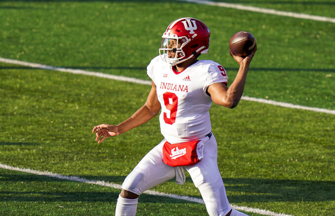 Indiana quarterback Michael Penix Jr. throws a pass during the second quarter of the team's NCAA college football game against Rutgers, Saturday, Oct. 31, 2020, in Piscataway, N.J. (AP Photo/Corey Sipkin)