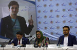 Hawa Alam Nuristani, chief of Election Commission of Afghanistan, center, speaks during a press conference at the Independent Election Commission office in Kabul, Afghanistan, Tuesday, Feb. 18, 2020. The Afghan Independent Election Commission said Tuesday that President Ashraf Ghani has won a second term as president. (AP Photo/Rahmat Gul)