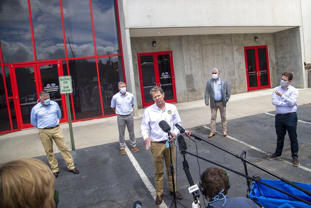 Governor Brian Kemp (center) makes a statement and answers questions following a tour of Fieldale Farms while visiting Gainesville, Friday, May 15, 2020. (Alyssa Pointer/Atlanta Journal-Constitution via AP)