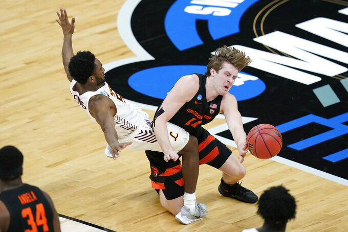 Oregon State guard Zach Reichle (11) collides with Loyola Chicago guard Keith Clemons, left, during the first half of a Sweet 16 game in the NCAA men's college basketball tournament at Bankers Life Fieldhouse, Saturday, March 27, 2021, in Indianapolis. (AP Photo/Darron Cummings)