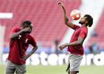 Liverpool forward Divock Origi controls the ball watched by Sadio Mane during a training session at the Wanda Metropolitano stadium in Madrid, Friday May 31, 2019. English Premier League teams Liverpool and Tottenham Hotspur are preparing for the Champions League final which takes place in Madrid on Saturday night. (AP Photo/Manu Fernandez)