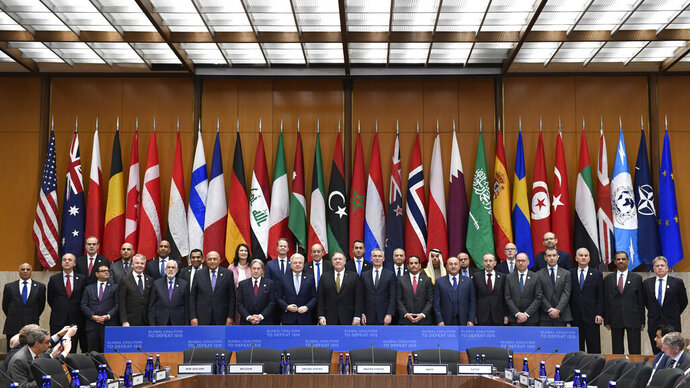 Secretary of Sate Mike Pompeo, center, and other foreign ministers and foreign officials pose for a family photo at the State Department in Washington, Thursday, Nov. 14, 2019, for the Global Coalition to Defeat ISIS Small Group Ministerial meeting. (AP Photo/Susan Walsh)