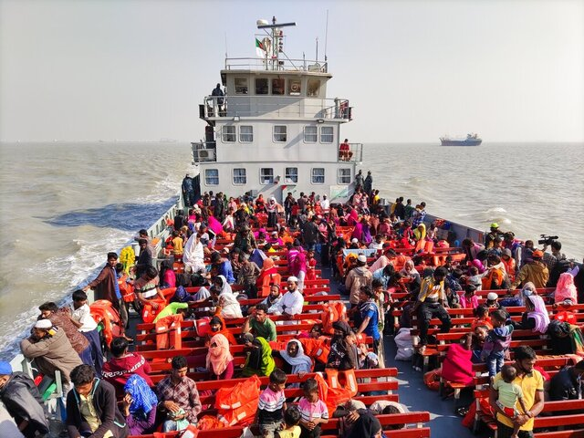Rohingya refugees travel in a naval ship to be transported to an isolated island in the Bay of Bengal, in Chittagong, Bangladesh, Tuesday, Dec. 29, 2020. Officials in Bangladesh sent a second group of Rohingya refugees to the island on Monday despite calls by human rights groups for a halt to the process. The Prime Minister's Office said in a statement that more than 1,500 Rohingya refugees left Cox's Bazar voluntarily under government management. Authorities say the refugees were selected for relocation based on their willingness, and that no pressure was applied on them. But several human rights and activist groups say some refugees have been forced to go to the island, located 21 miles (34 kilometers) from the mainland. (AP Photo/Mahmud Hossain Opu)