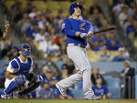 Chicago Cubs' Anthony Rizzo and Los Angeles Dodgers catcher Austin Barnes watches Rizzo's two-run home run during the ninth inning of a baseball game in Los Angeles, Saturday, June 15, 2019. (AP Photo/Alex Gallardo)