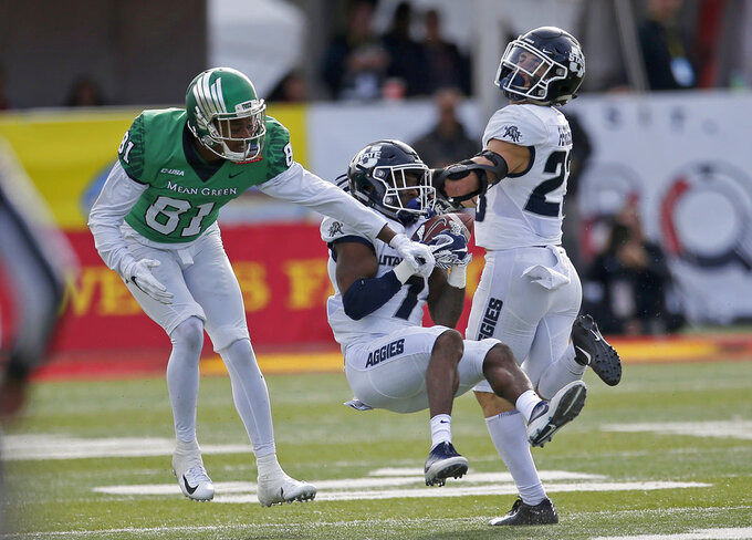 Utah State cornerback DJ Williams (7) intercept a pass intended for North Texas wide receiver Cudjoe Young (81) during the first half of the New Mexico Bowl NCAA college football game in Albuquerque, N.M., Saturday, Dec. 15, 2018. (AP Photo/Andres Leighton)