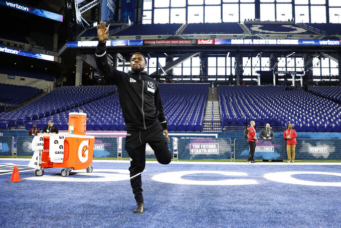 Utah defensive back Javelin K. Guidry stretches at the NFL football scouting combine in Indianapolis, Sunday, March 1, 2020. (AP Photo/Charlie Neibergall)