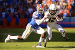 Missouri wide receiver Johnathon Johnson (12) is knocked out of bounds by Florida defensive back Chauncey Gardner-Johnson (23) after catching a pass during the first half of an NCAA college football game Saturday, Nov. 3, 2018, in Gainesville, Fla. (AP Photo/Phelan M. Ebenhack)