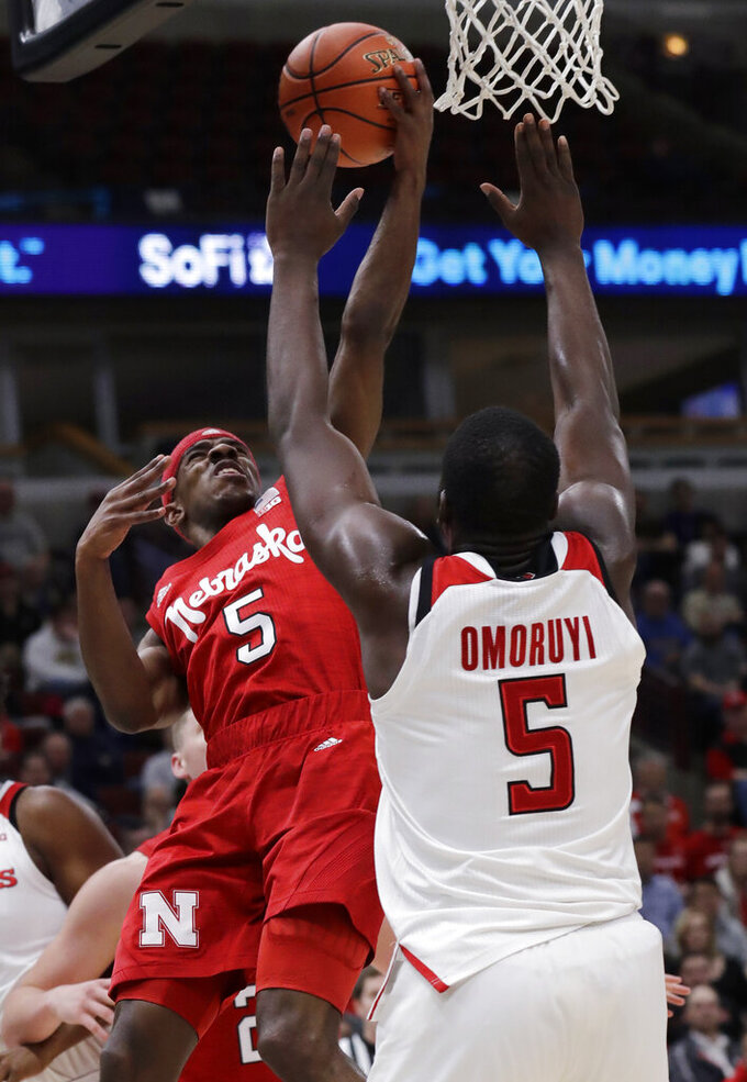 Nebraska guard Glynn Watson Jr., left, drives to the basket against Rutgers forward Eugene Omoruyi during the first half of an NCAA college basketball game in the first round of the Big Ten Conference tournament in Chicago, Wednesday, March 13, 2019. (AP Photo/Nam Y. Huh)