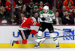 Chicago Blackhawks center Dylan Strome, left, is checked by Dallas Stars center Tyler Pitlick (18) during the first period of an NHL hockey game Friday, April 5, 2019, in Chicago. (AP Photo/Matt Marton)