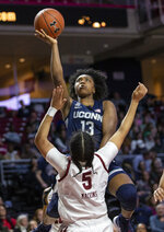 Connecticut guard Christyn Williams (13) shoots over Temple guard Marissa Mackins (5) during the first half of an NCAA college basketball game Sunday, Nov. 17, 2019, in Philadelphia. (AP Photo/Laurence Kesterson)