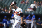 Baltimore Orioles starting pitcher Zac Lowther walks to the dugout after giving up five runs to the Toronto Blue Jays in the first inning of a baseball game Sunday, Sept. 12, 2021, in Baltimore. (AP Photo/Gail Burton)