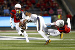 California quarterback Brandon McIlwain (5) is tackled by Arizona safety Demetrius Flannigan-Fowles (6) during the first half of an NCAA college football game Saturday, Oct. 6, 2018, in Tucson, Ariz. (AP Photo/Chris Coduto)