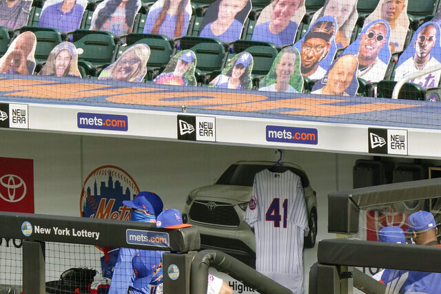 Tom Seaver's No. 41 jersey hangs in the New York Mets dugout before the start of a baseball game against the New York Yankees at Citi Field, Thursday, Sept. 3, 2020, in New York. Seaver died on Aug. 31. (AP Photo/Kathy Willens)