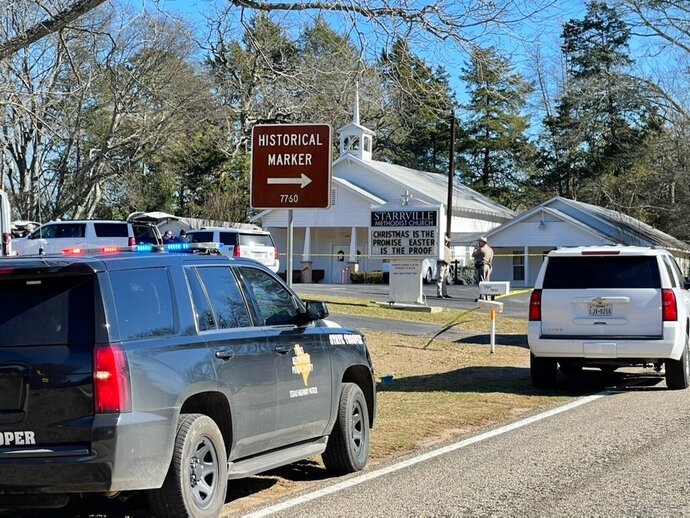 The Smith County Sheriff's Office investigates a fatal shooting incident at the Starville Methodist Church in Winona, Texas, on Sunday morning, Jan. 3, 2021. A suspect who fled has been arrested, said the sheriff's office. (Zak Wellerman/Tyler Morning Telegraph via AP)